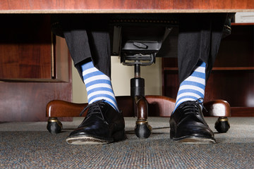 Businessman with striped socks