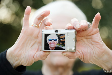 Senior woman taking a self portrait photograph