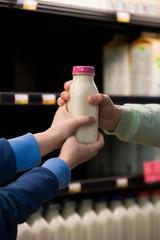 Children holding a bottle of milk