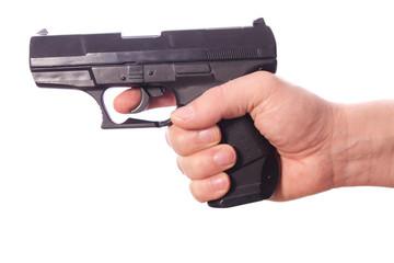 Hand hält eine Waffe