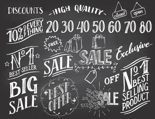 Sale hand-lettering and hand-drawn design elements set on blackboard background with chalk