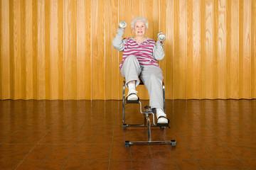 Senior woman exercising holding dumbbells