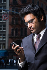 Businessman reading a text message