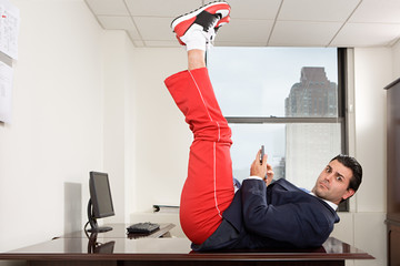Businessman exercising in office