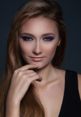 Portrait of beautiful woman with bright evening make up.