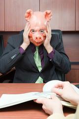 Stressed businessman in pig mask