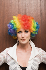 Businesswoman wearing clown wig