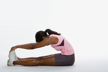 one woman stretching