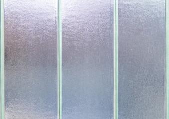 Photo of a striped glass window background pattern