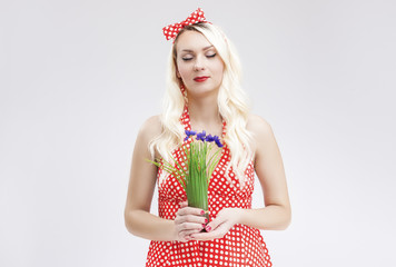 Sensual Caucasian Blond Female in Red Polka Dotted Dress Dreaming