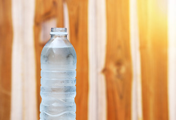 A bottle of Drinking water on wooden background