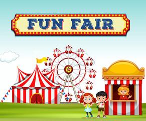Children buying ticket at fun fair