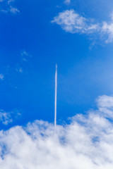 abstract contrail cloud on the blue sky