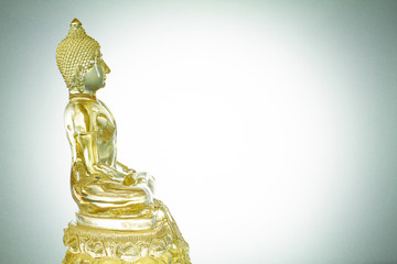 Side view of white mixed with golden transparent glass buddha st