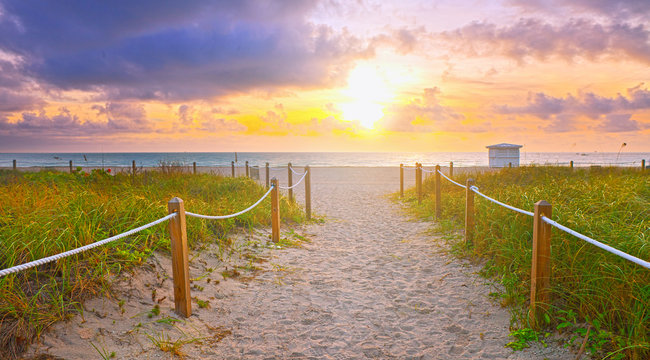 Path on the sand going to the ocean in Miami Beach Florida at sunrise or sunset, beautiful nature landscape, retro instagram filter for vintage looks
