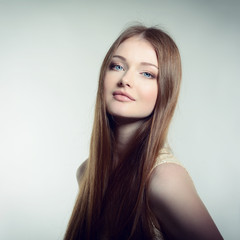 Pretty woman. Portrait of young attractive woman. Image toned.