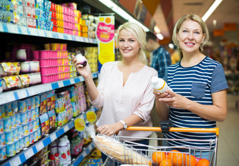 Female choosing fruit yoghurt