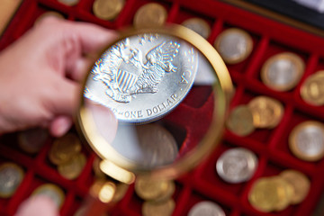American dollar under magnifying glass