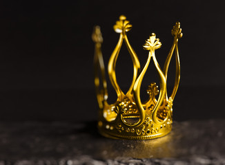 Golden crown with dark background