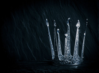 Silver crown with dark background