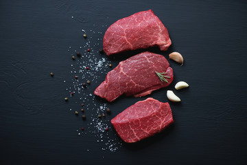 Deurstickers Vlees Top view of black angus beef steaks with seasonings, studio shot