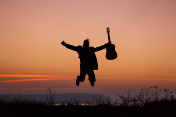 Man jumping with guitar