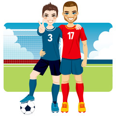 Two soccer players friends and rivals of competing teams together on a soccer field