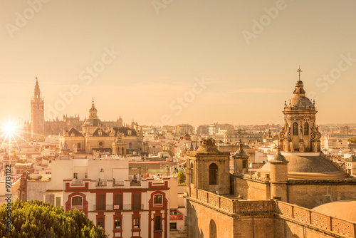 Wall mural Aerial view of the roofs and the cathedral of Seville, Andalusia, Spain