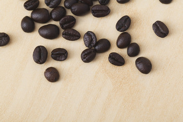 Brown coffee beans on wood paper background