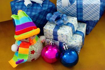 Snowman and gift box with christmas ball
