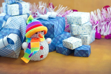 Snowman and gift box on the floor