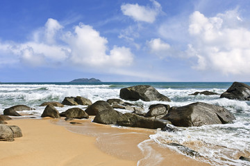 Rock formation in the surf of Sanya, Hainan Island, China