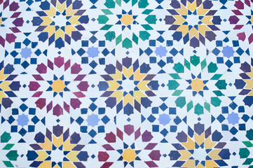 Beautiful colorful Moroccan mosaic pattern resembling flowers on white background