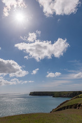 Welsh coast line with blue sky and sun