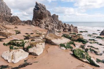 Large and small rocks on beach around coast