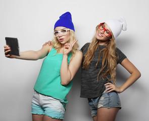 two hipster girls friends taking selfie