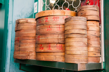 Stack of bamboo Chinese cooking steam baskets on shelf