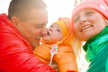young family  portrait autumn with their kid