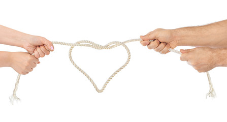 Man and woman hands with heart shaped rope