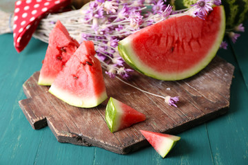 Sliced watermelon on decorated wooden background