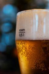 glass of foamy golden beer