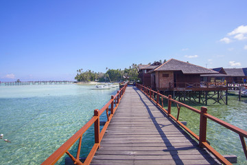 beautiful floating chalet at mabul island aand blue sky