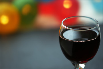 A glass of red wine on blurred background