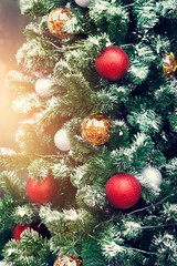 Colorful decorating christmas tree on lighting background