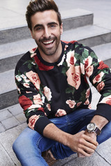 Smiling young man in floral top, portrait