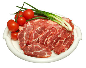 white plate containing raw beef with white strains of fat, strains of bunch onion and cherry tomatoes on the side