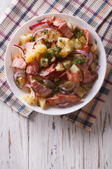 Potato salad with bacon and onions. vertical top view