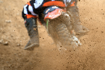 Flying debris from a motocross in dirt track Wall mural
