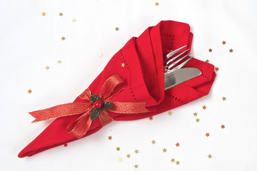 Knife and Fork wrapped in red linen napkin