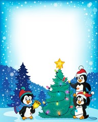 Frame with penguins and Christmas tree